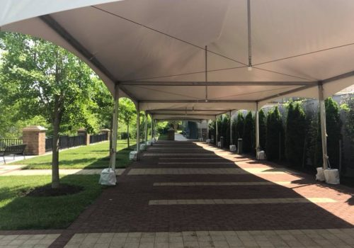 festival-tents-on-brick-sidewalk_orig