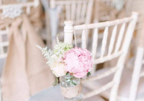 White Chiavari Chairs with Pink Flower
