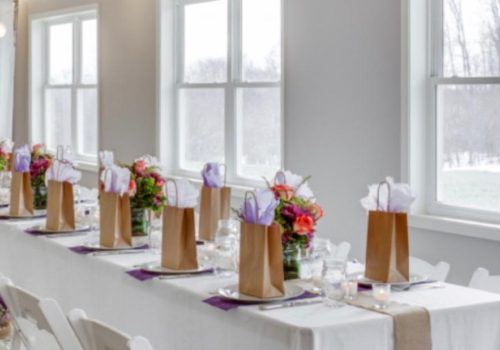 Long table with White Resin Padded Chairs