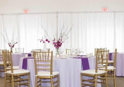 Round tables with Gold Resin Chiavari Chairs